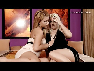 Hot lesbian scene in bed with two sexy babes