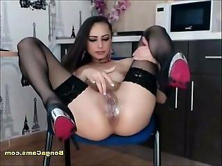 Fabulous dark haired chick masturbates in the kitchen