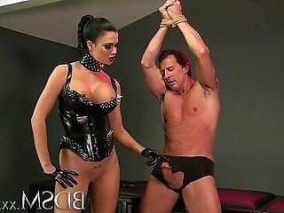 BDSM Slave boy in metal stocks as he receives anal attention