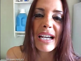 Mature brunette winking asshole