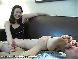 College girl gives a hand job while her feet are licked