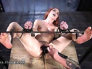 Redhead sub in device bondage toyed